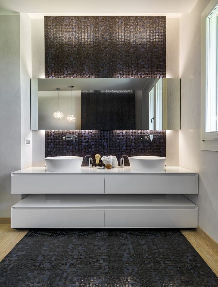 Instead of a free-standing sink consider a counter-top for a little more luxury, they certainly help keep the clutter under control and they just look more sleek and elegant.