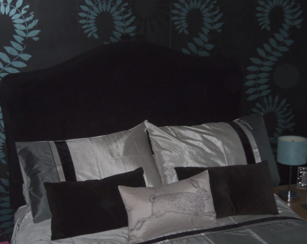 silver and black bed linen