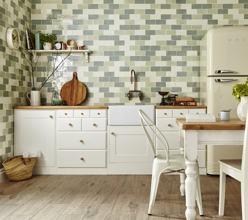 Green and cream metro tiles in a country style kitchen
