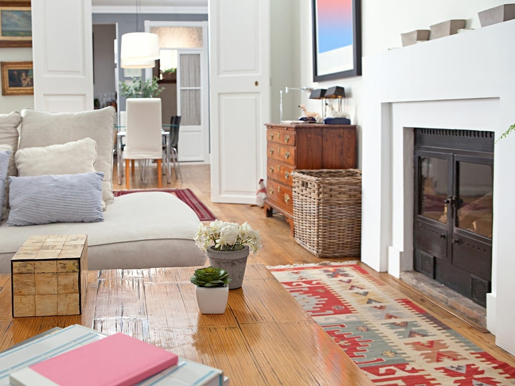 A country cottage living room with stove fireplace