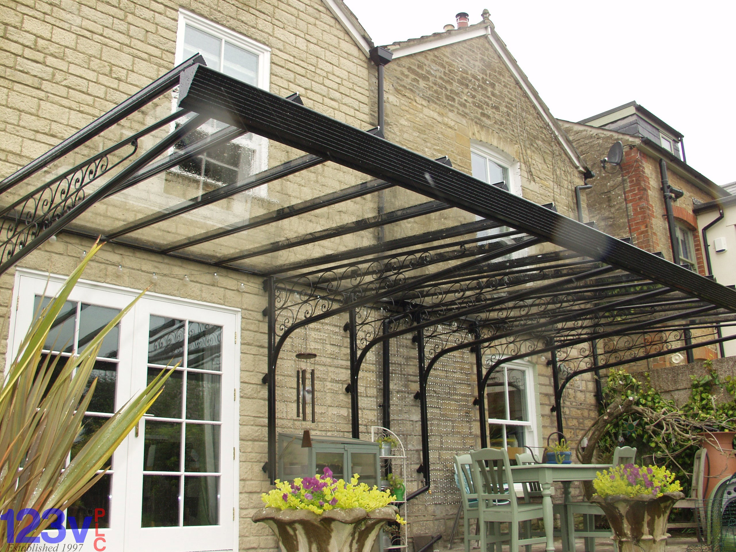 Patio canopy clear as glass canopies garden awnings made for Glass awnings for home
