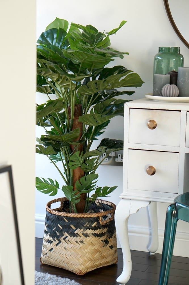 How to use faux plants in your home. Faux plants look just as good as real life plants and need little or no care. Add them to your living room, conservatory or bedroom, enhance your decor, get ideas and tips on how to make them look great! Click through to see more!
