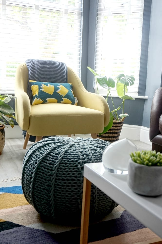 Living room makeover with dark walls and pops of colour, plus vinyl flooring and contemporary accessories
