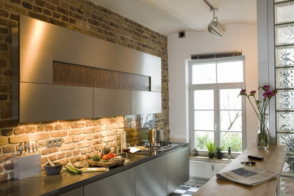Modern kitchen area with exposed brick slips wall