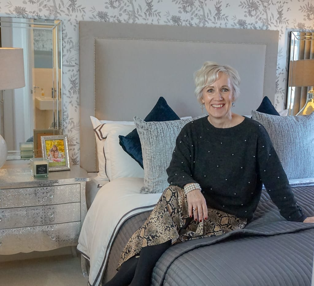 Woman on a bed in Miller Homes