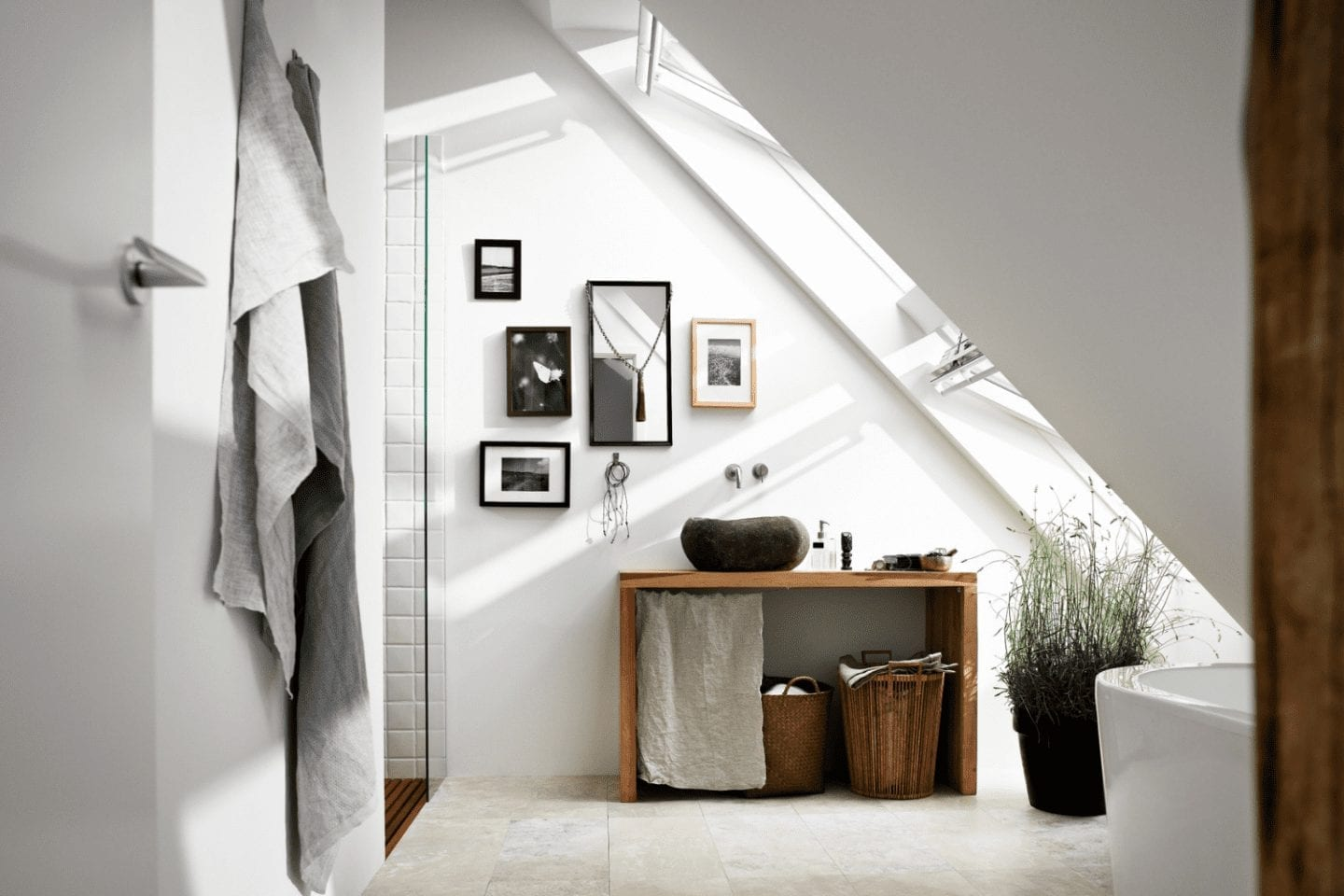 Loft bathroom built into the eaves of a loft conversion with roof windows