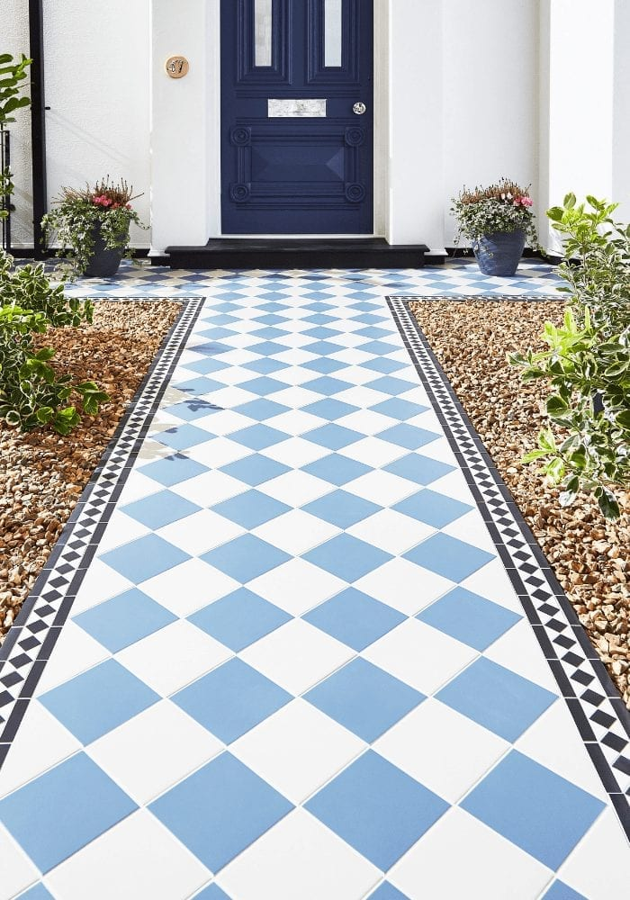 blue and white diamond path to a front door