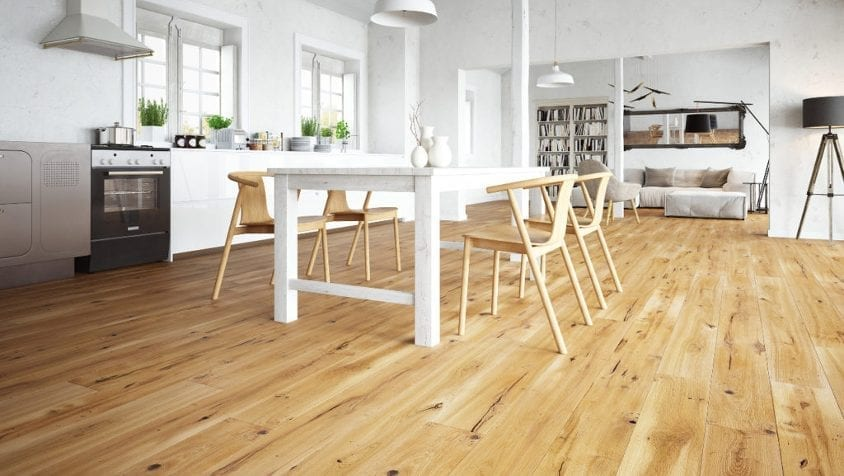 white kitchen with rustic wood floor and table and chairs