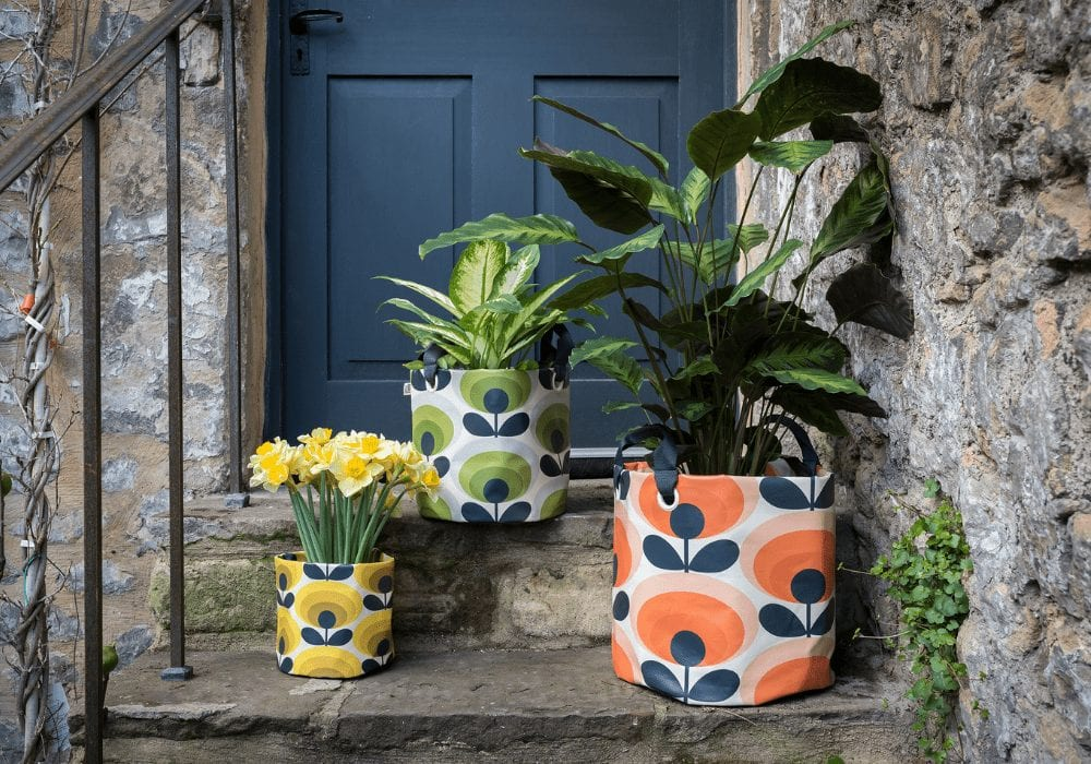colourful flower bags on a doorstep garden trends 2019
