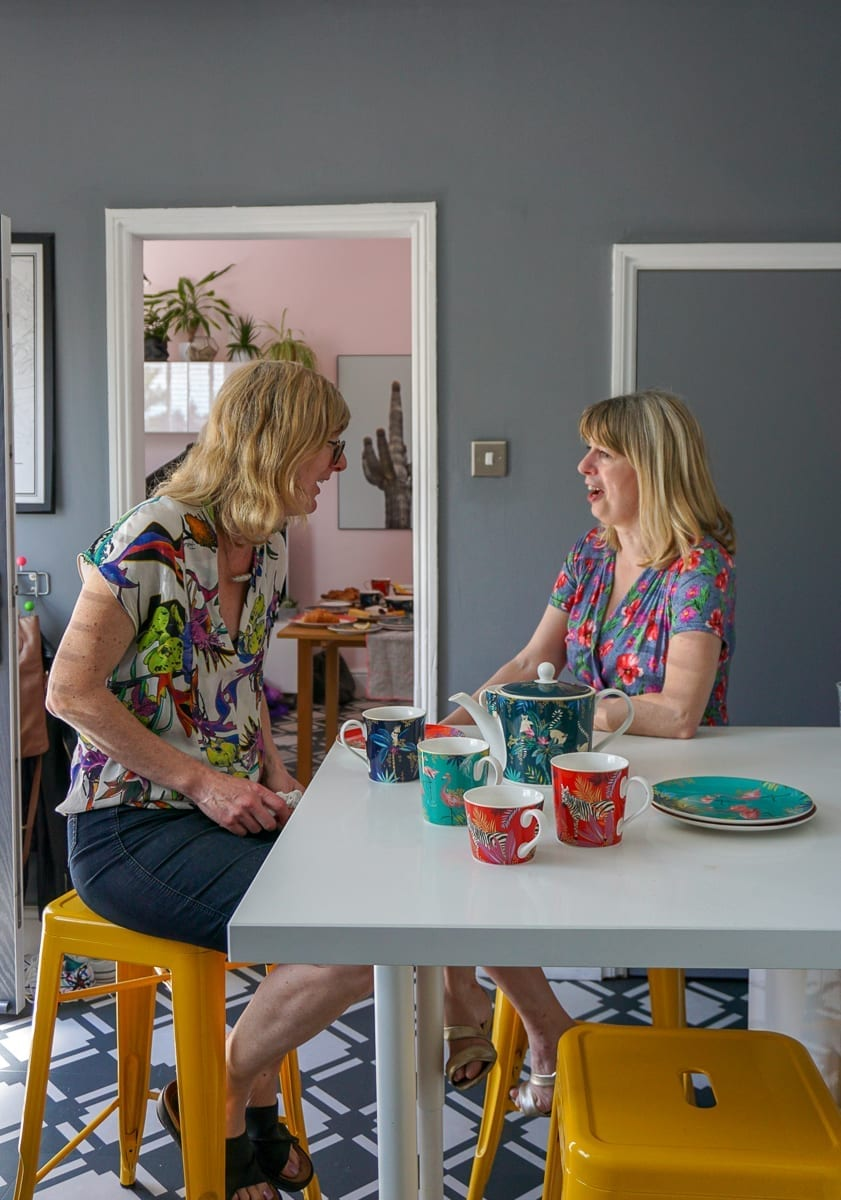 Two women chatting at the breakfast bar