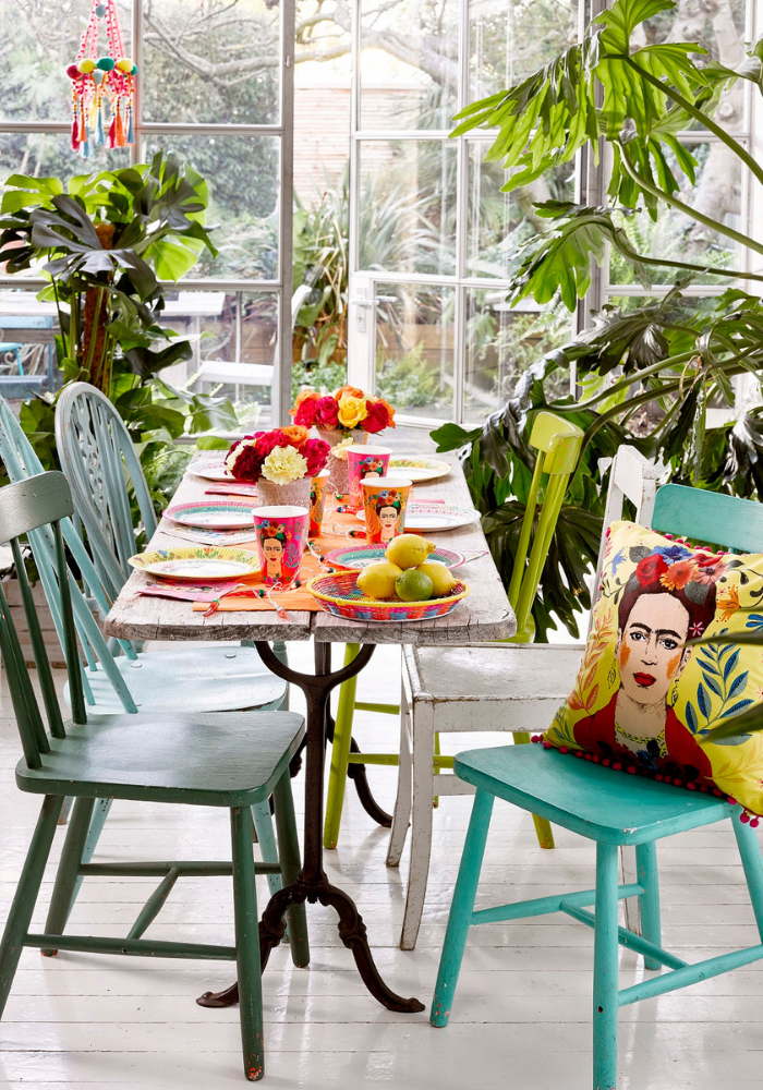 conservatory long table and bright coloured chairs