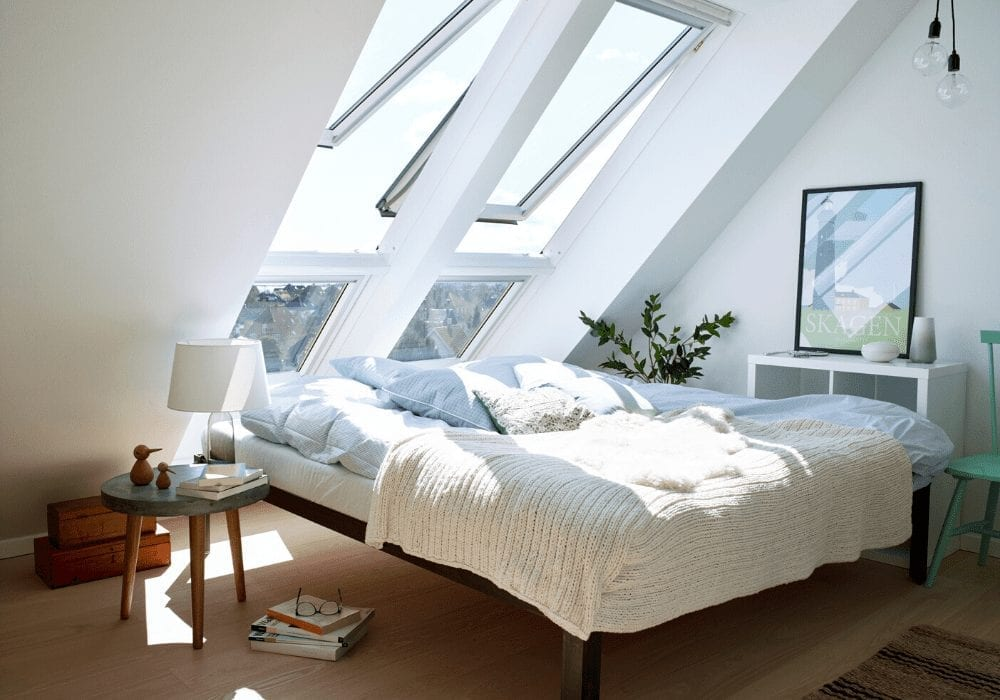 loft bedroom witih bed and roof windows