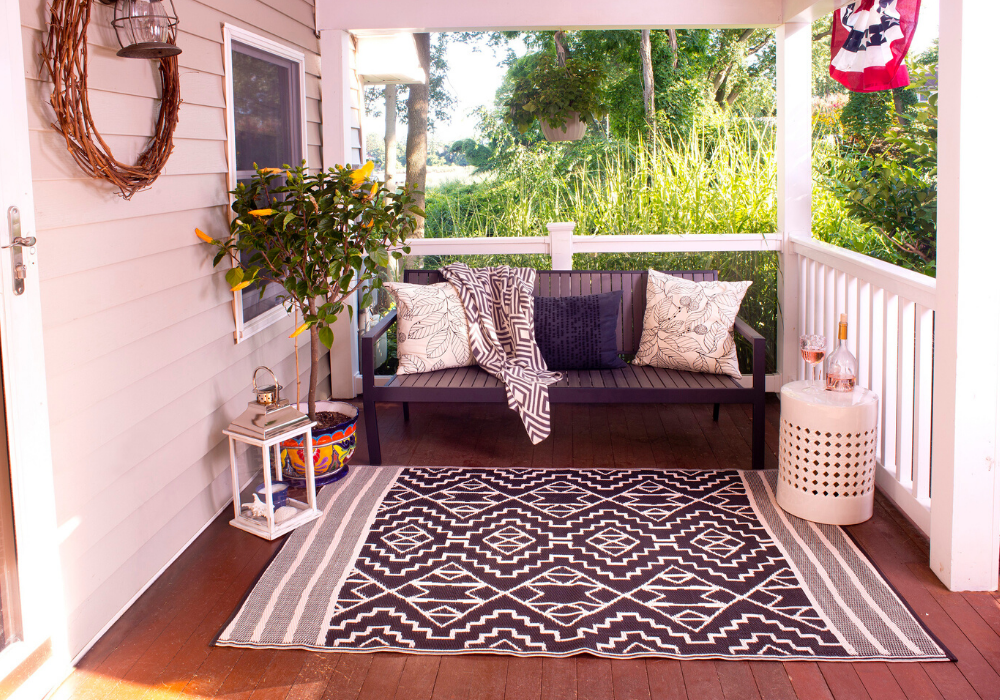 large porch with sofa and eco friendly monochrome rug