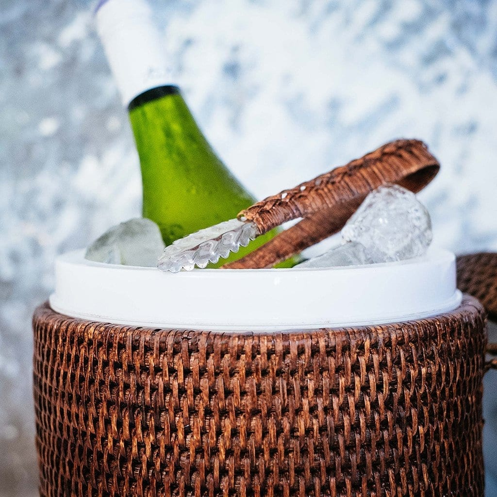 Brown rattan ice bucket with bottle
