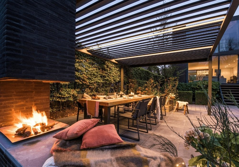 large garden seating area with fire pit and canopy