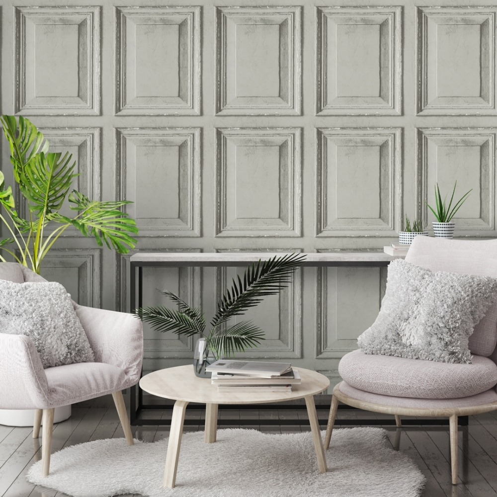Aged faux wood panel wallpaper in off white with pink chairs and a variety of green plants