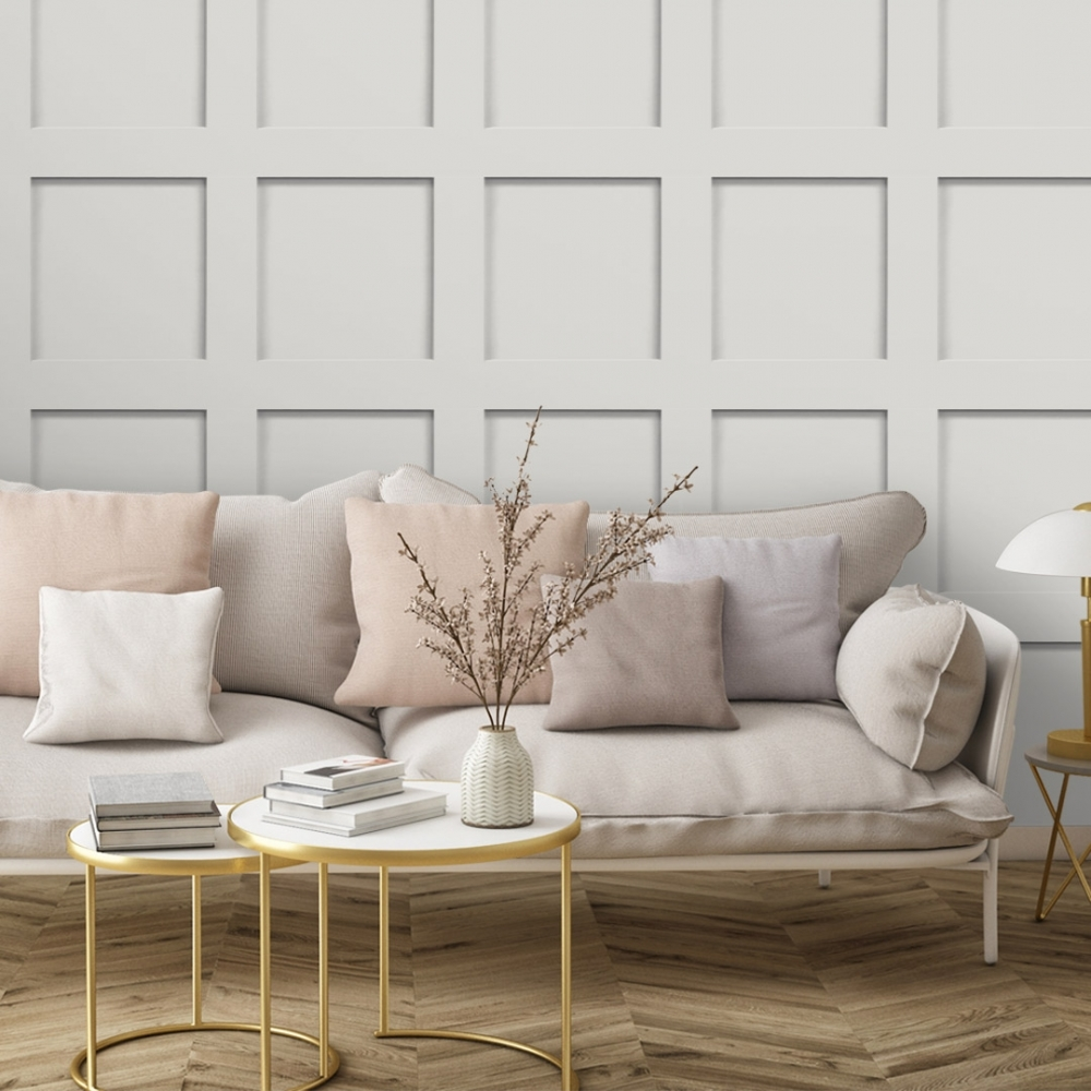 off white wood panel wallpaper with a beige sofa and pink cushions