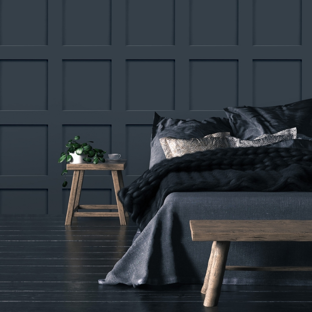 Dark blue wood effect wallpaper in a bedroom with dark blue bedding on the bed
