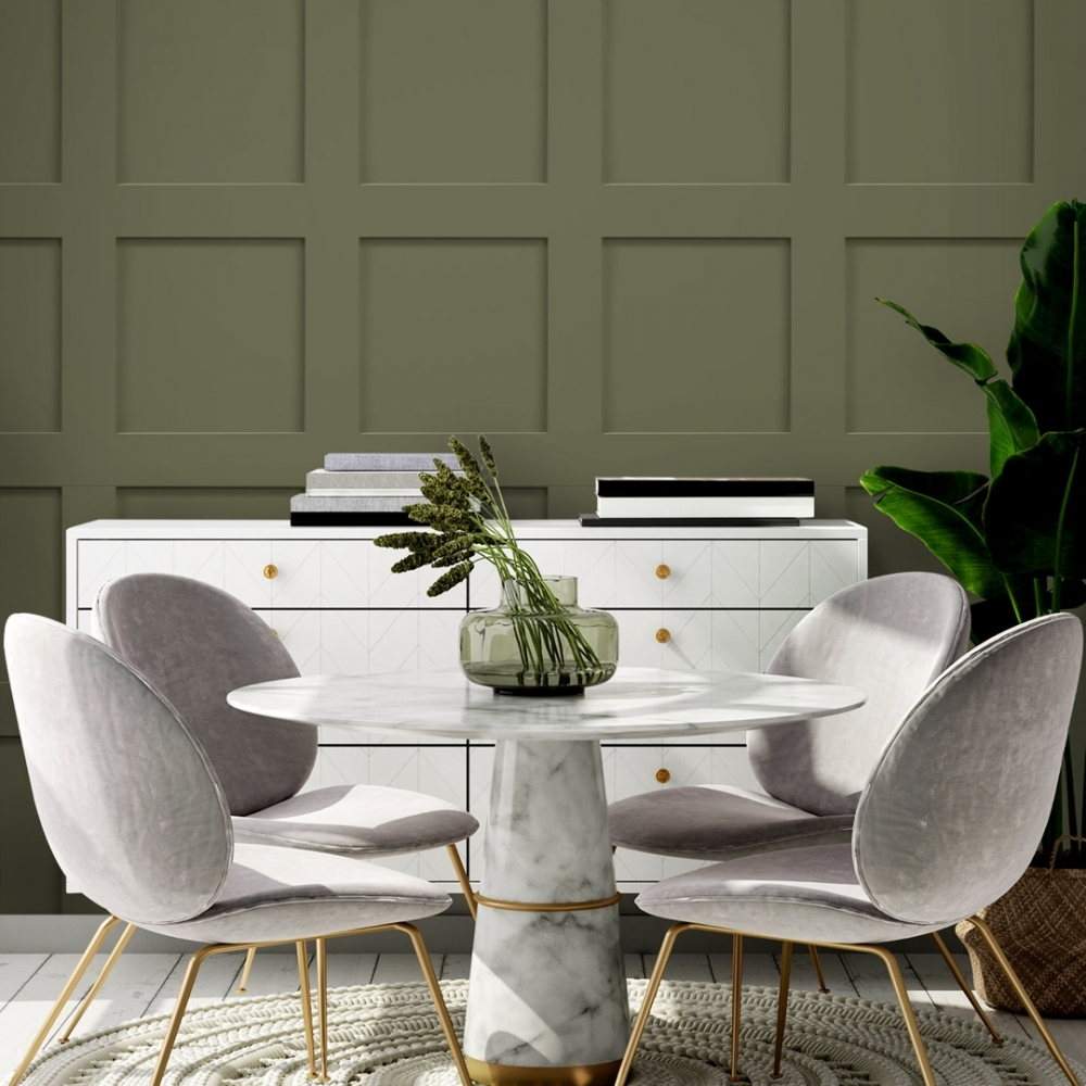 green wood panel wallpaper with a white chest of drawers, white table and grey chairs.
