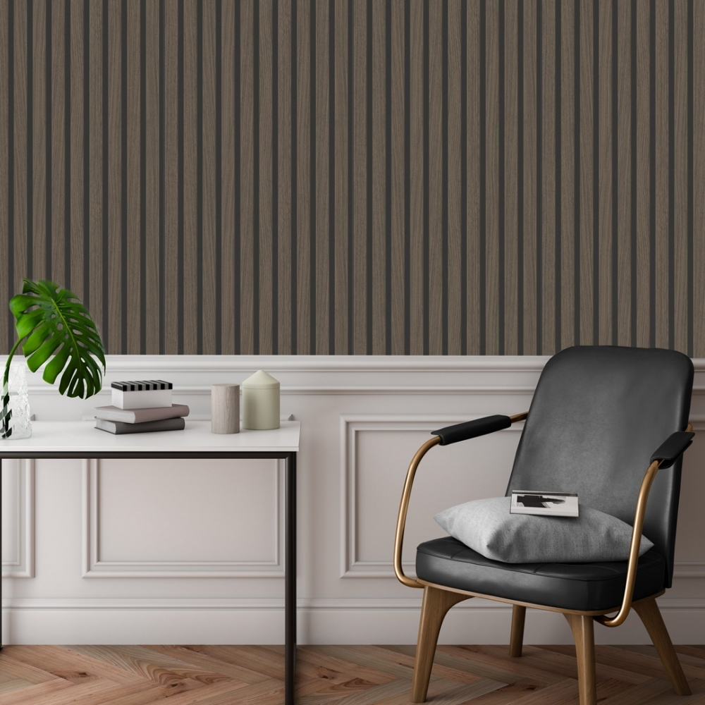 Dark walnut wood effect wallpaper with a pink traditional wood panel beneath, and a black leather chair