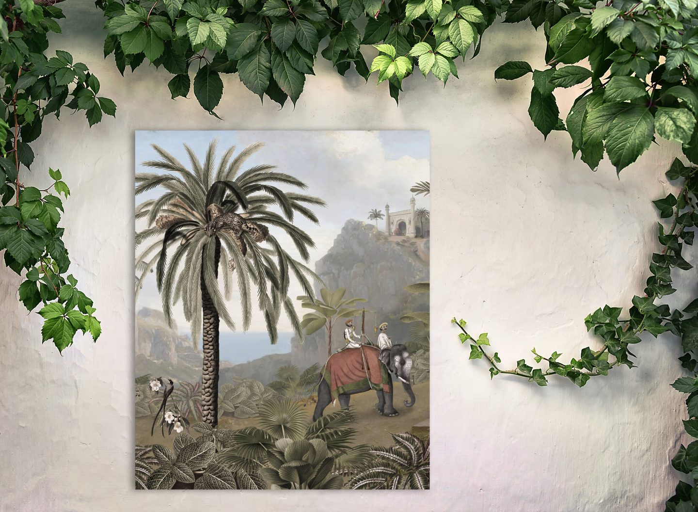 Metal print on a white outdoor wall showing an elephant and palm tree